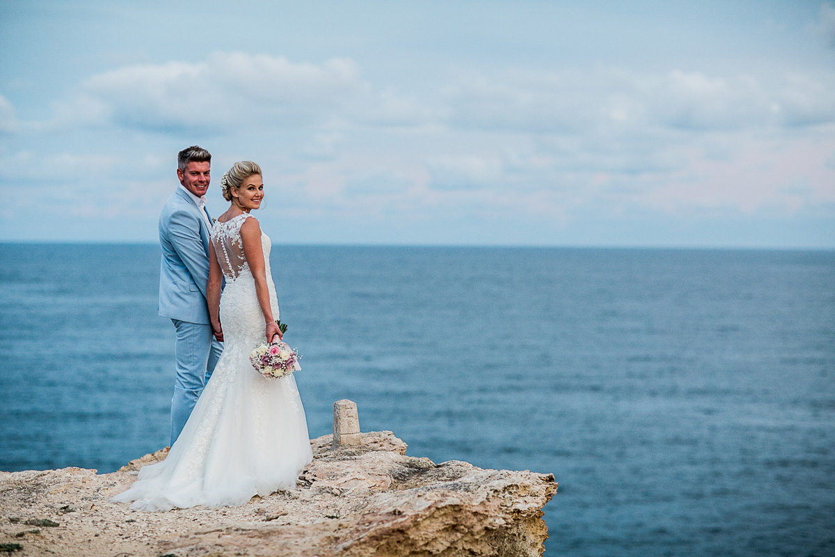Couple on a cliff in ibiza