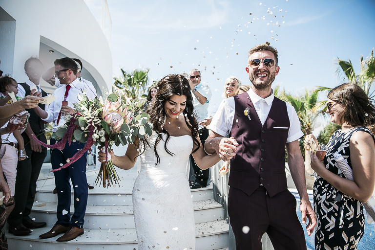 couple having confetti thrown on them