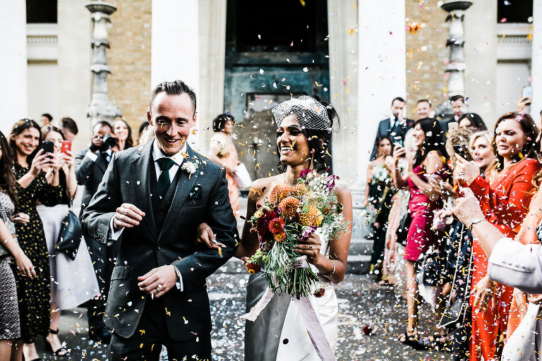 Bride and groom having confetti coming out of the Asylum chapel in London