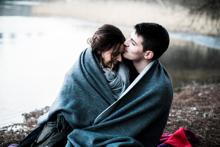 A couple cuddling at the lake at saville gardens