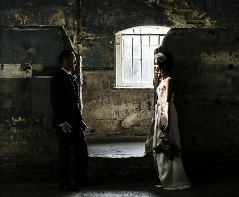 Bride and groom looking ta each other at the asylum