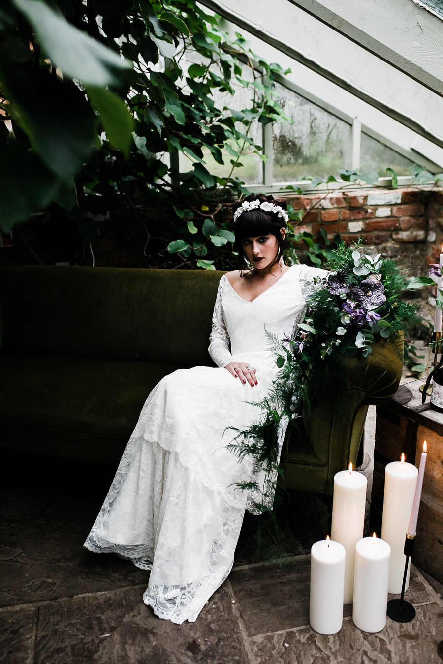 Bride looking at the camera at the secret garden in Kent