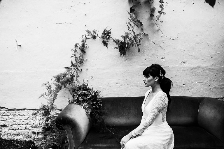 Bride sitting on sofa at the secret garden kent